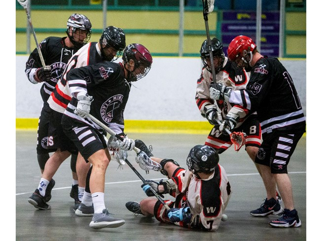 FLOORED – Paul Koch of the Edmonton Warriors is down and out with out the ball against the St. Albert Miners, with Randy Hanger on the right and John Lintz, front, and Graedon Cornfield on the left during Sunday's senior B match on Lacrosse Day in St. Albert. The Miners won 11-3 at Akinsdale Arena and Monday's 8-6 result against the Beaumont Outlaws at Go Auto Arena was the third win in four games for the Miners to start off the season as the three-time defending President's Cup national champions. 