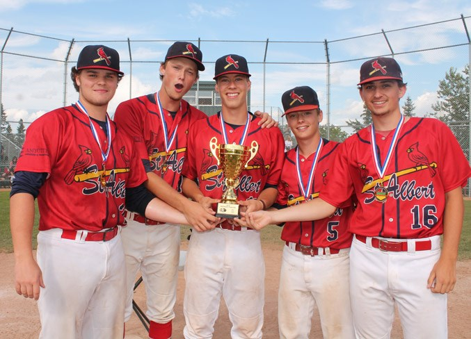 CUP HOLDERS – Liam Froment, left, Ryan Marples, Mike Brisson, Evan Bourassa and Brady Kobitowich of the St. Albert Cardinals show off the Baseball Alberta 18U AAA TIer I championship trophy during Sunday's post-game ceremony at Centennial Park in Sherwood Park. The Cardinals repeated by shutting out the Northern Lights of Grande Prairie 9-0 in the final to finish 5-0 at provincials. JEFF HANSEN/St. Albert Gazette