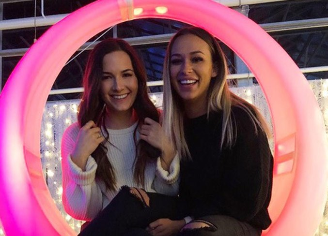 Singer-songwriter Lia Cole, left, shares a moment of Joy with her best friend Taya Martin at St. Albert's Christmas Glow Festival. Cole's latest song, For You, is dedicated to Martin, 20, who died by suicide in early January.