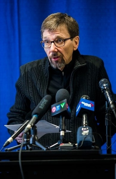 Bret McCann speaks with media at a press conference on Sunday at the St. Albert Inn as he and St. Albert-Edmonton MP Michael Cooper discussed their concerns about a lack of