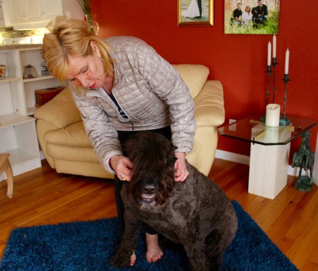 Holly Tibble pets her nine-year-old dog Bear