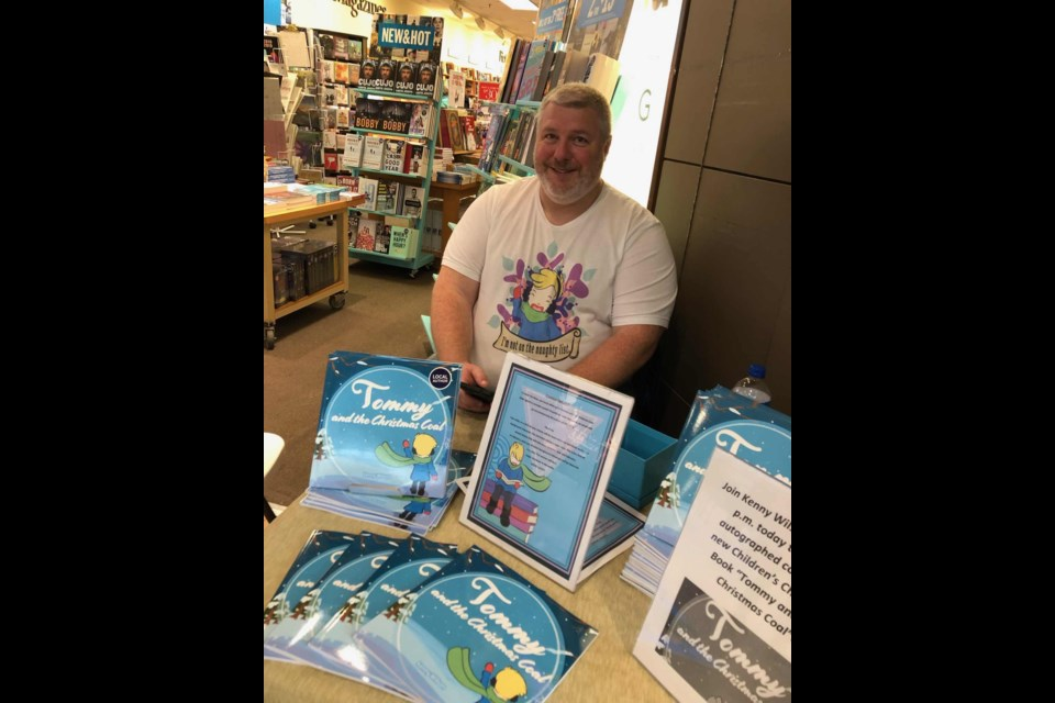 "Ken Wilson at the recent book signing for ""Tommy and the Christmas Coal."" (Supplied)"