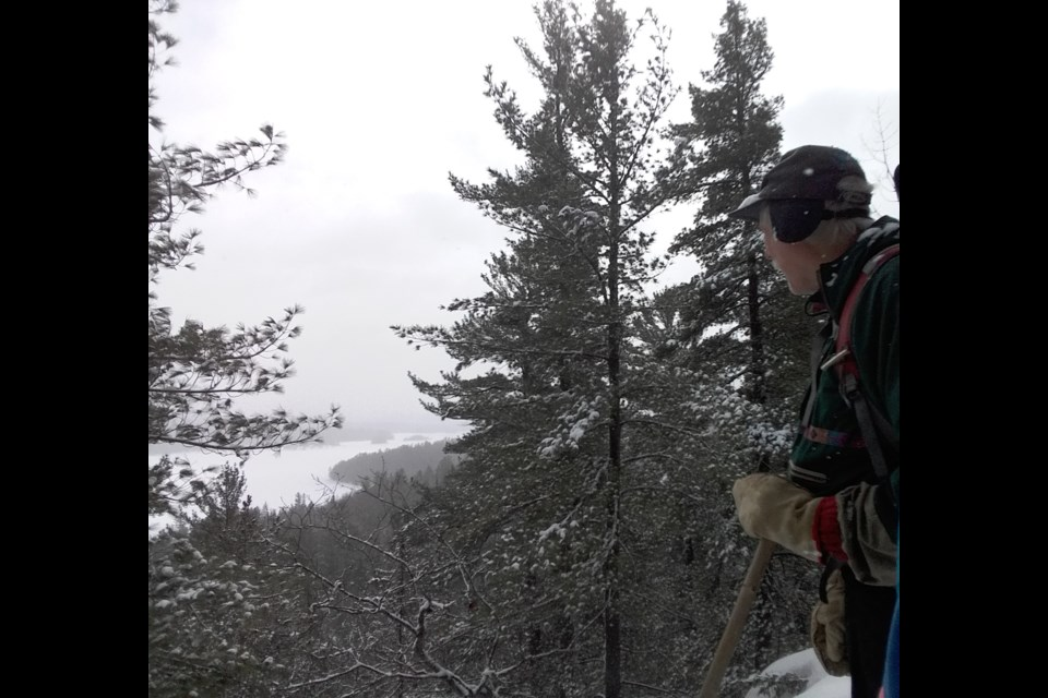Allan looks out over one of the many breathtaking landscapes we find while out snowshoeing. (Supplied)
