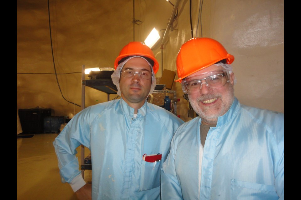 "Poet Thierry Dimanche and composer Robert Lemay suited up for art, while producing ""2000 meters underground,"" a composition of music and poetry recorded two kilometres below ground in the SNOLAB research facility. (Supplied)"
