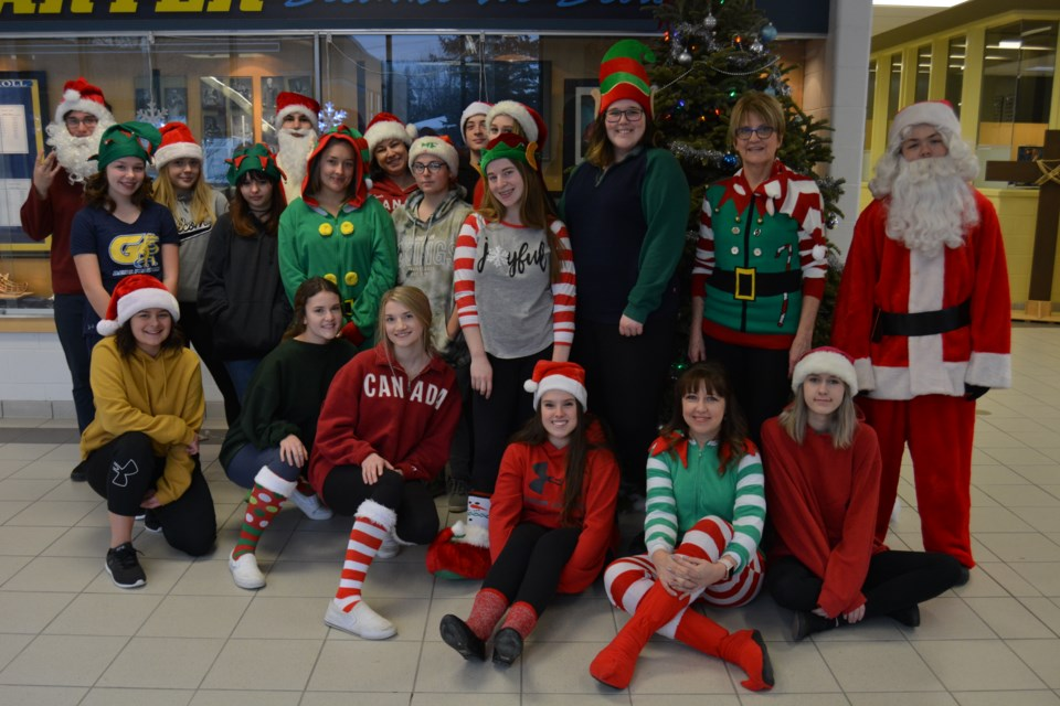 Students and staff at Bishop Alexander Carter Catholic Secondary School got in the Christmas spirit today, with many dressing up as elves or the chief elf himself, Santa Claus. (Supplied)