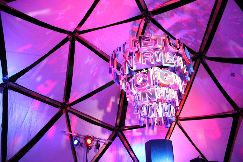 A 2018 installation in the iconic Up Here dome, a geodesic dome built of wood that is the centrepiece on newly sodded Durham Street. (Photo: Ella Jane Myers)