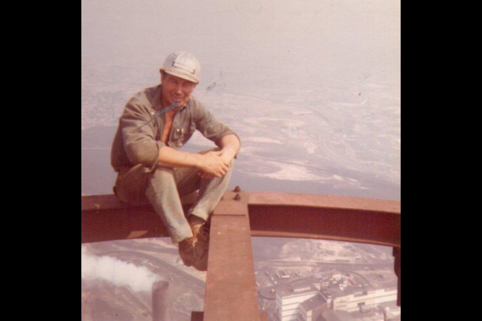 Aarne Kovala is seen here sitting on the top of the Sudbury Superstack, which he helped to build in the 1970s. (Supplied)