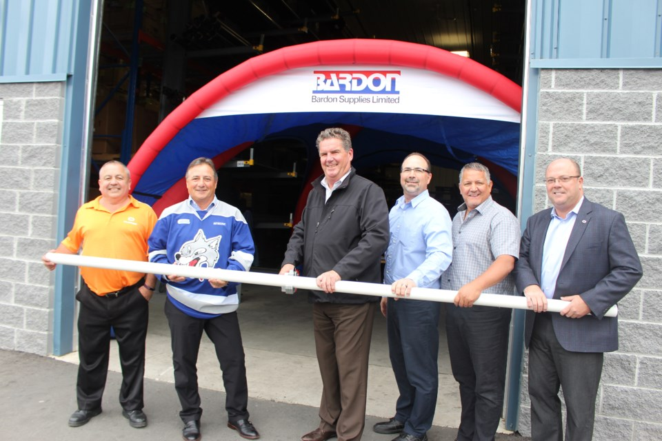 Flocor welcomed southern HVAC and plumbing supplier Bardon Supplies to Sudbury with a non-traditional ribbon cutting on Oct. 5. From left are: Bardon/Flocor branch manager Craig Wafer, Deschênes Group vice-president of operations Joe Senese, vice-president/general manager of Bardon Supplies Bob Pryor, Eastern manager of Bardon Supplies Shawn Taylor, regional manager of Bardon Supplies North Steve Board, vice-president/general manager of Flocor Tom Murrary. (Heather Green-Oliver/Sudbury.com)