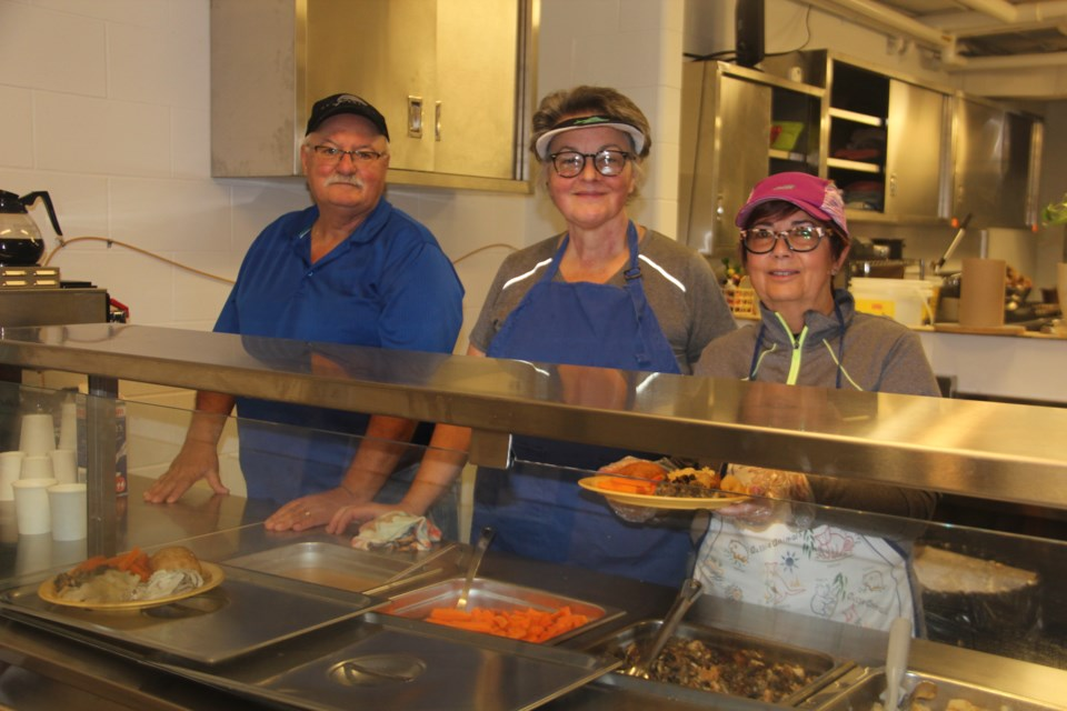 From left are Blue Door Soup Kitchen volunteers Domenic Mattiazzi, Diane Laban and Debbie Mattiazzi. (Heidi Ulrichsen/Sudbury.com)