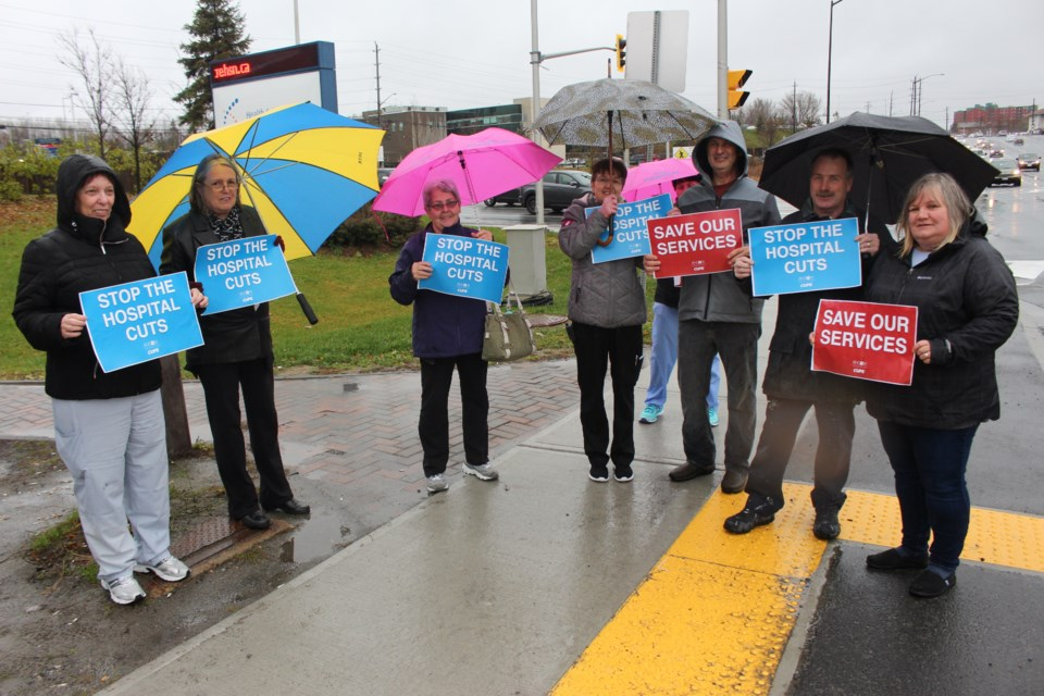 A handful of HSN employees braved some inclement weather on Tuesday as they rallied along Paris Street to send a message to Premier Doug Ford that Sudbury's hospital is not being properly funded. (Matt Durnan/Sudbury.com)