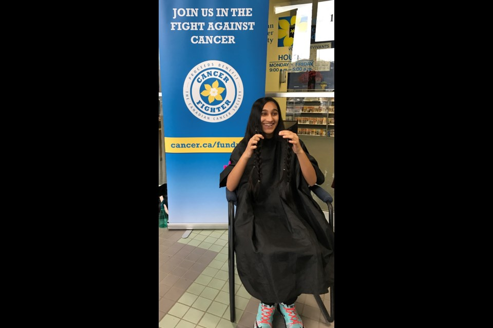 Rasksheen Khan proudly presents her hair, which will be donated to Pantene Beautiful Lengths and used to make wigs for women undergoing cancer treatment. Supplied photo.