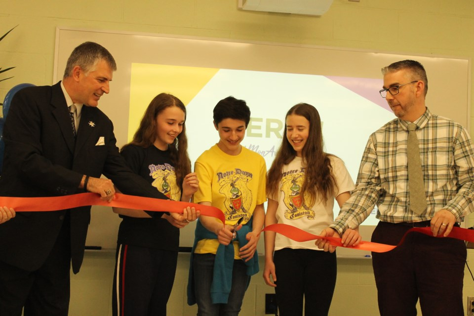 The ribbon was cut on École Notre-Dame de la Merci's revamped library May 6. From left are Paul Henry, superintendent with the CSCNO, students Zoe Booth, Kieon Audette and Vanessa Major, and École Notre-Dame de la Merci principal Yves Vaillancourt. (Annie Duncan/Sudbury.com)y