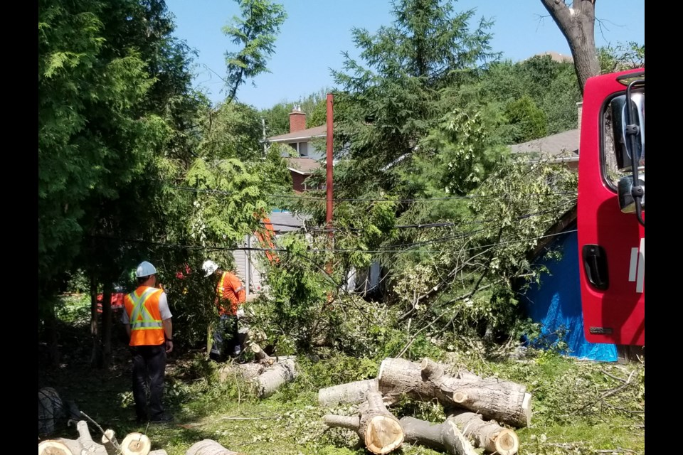 The work to restore power to hundreds of New Sudbury residents continues today, with about 300 customers still without electricity today after a powerful downburst Monday afternoon. (Supplied)