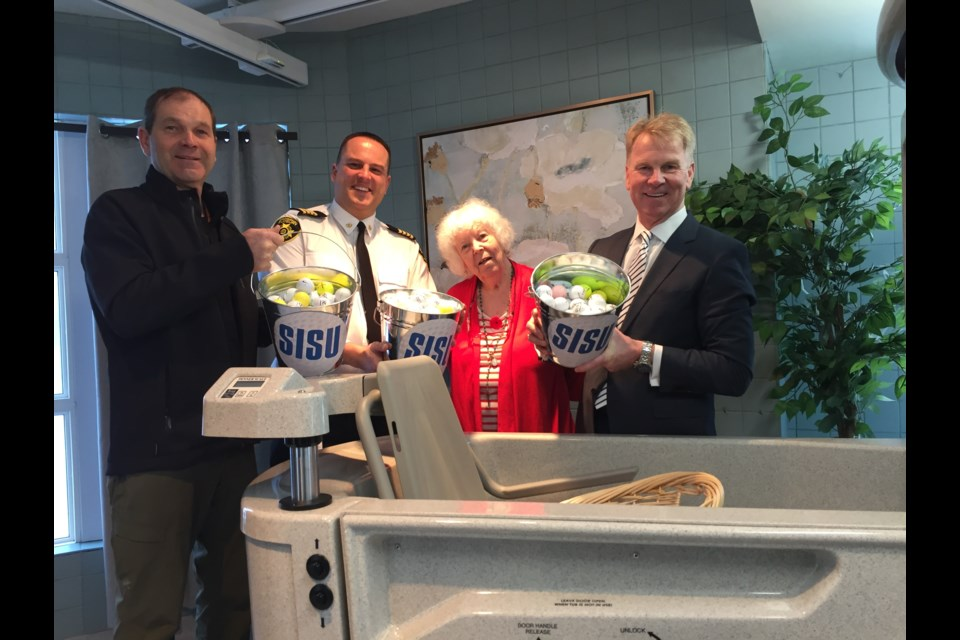 The second annual SISU Ball Drop Lottery kicked off this morning at Finlandia Village with a ceremonial ball drop. L-R: Brian Ramakko from Ramakko's Source for Adventure, Greater Sudbury Fire Services assistant deputy fire chief Jesse O'Shell, Finlandia resident Louise Mokohonuk, Ed Reilly of Freelandt Caldwell Reilly. (Heather Green-Oliver/Sudbury.com)
