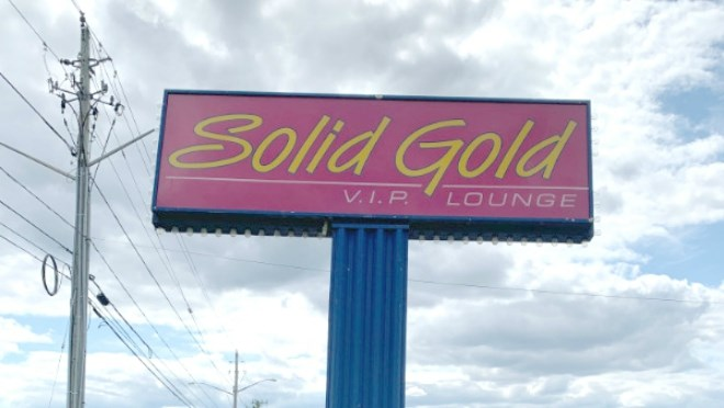 This well known sign outside the former strip club on Falconbridge Road will be gone next week. (Supplied)