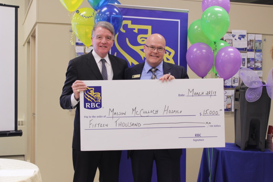 Scott Sonder (left), regional VP for RBC, presents a $15,000 donation March 28 to Gerry Lougheed, Jr., chair of the Maison McCulloch Hospice board at a kick-off event for the annual RBC Hike for Hospice. (Callam Rodya)