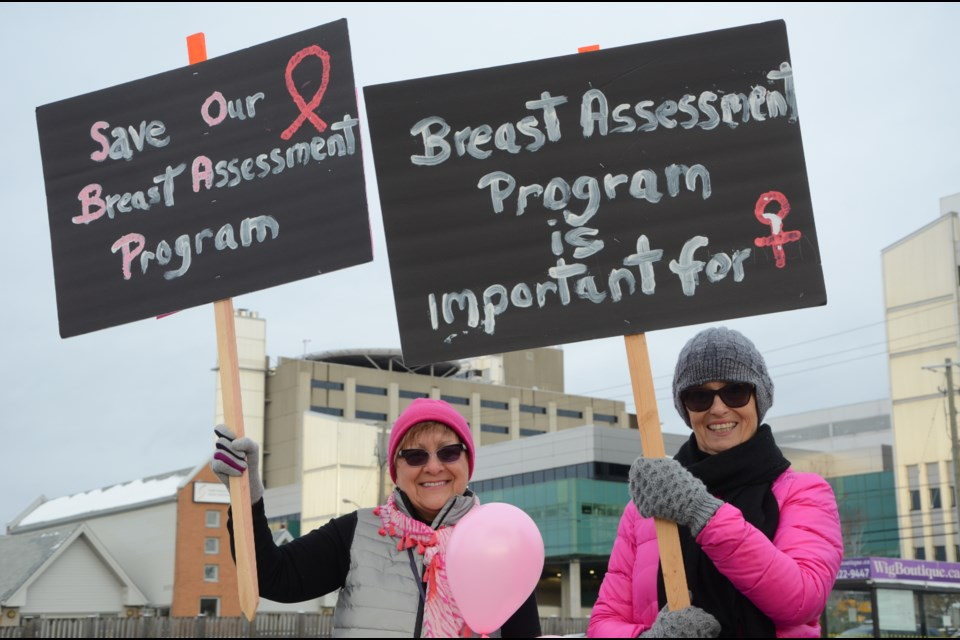 Dozens of people protested outside of Health Sciences North Monday to put pressure on hospital administration not to make cuts to its breast assessment program. (Arron Pickard/Sudbury.com)