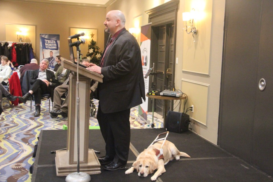 Independent Living Sudbury Manitoulin executive director Rob DiMeglio and his guide dog Fianna at the 10th annual Persons with Disabilities Breakfast Nov. 30. (Heidi Ulrichsen/Sudbury.com)