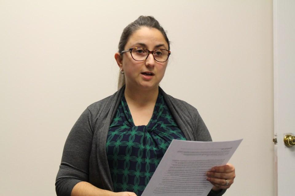 Sudbury Women's Centre executive director Giulia Carpenter speaks at a Dec. 6 vigil marking the École Polytechnique massacre. (Matt Durnan/Sudbury.com)