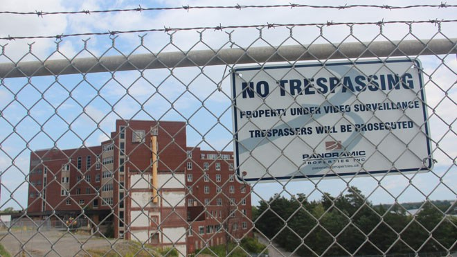 """Taken earlier this summer, this is the """"before"""" photo of the derelict former hospital site on Paris Street. (File)"""