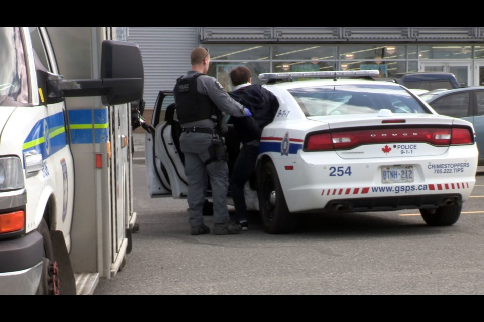 Greater Sudbury Police put the stabbing suspect in the back of a police cruiser following his arrest June 3. (Heather Green-Oliver / Sudbury.com)