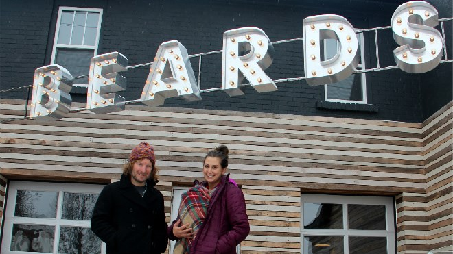 Mark Browning and Jessica Nadel (with two-month-old Juniper) show off the exterior of their new Kathleen Street vegan cafe and bakery, Beards. Photo by Heidi Ulrichsen.