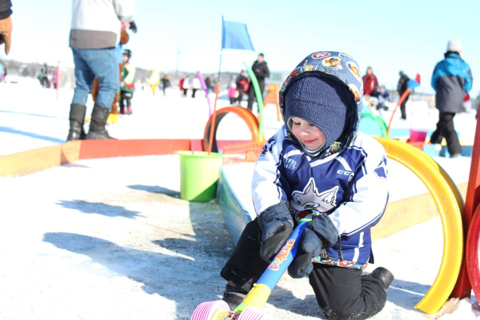 Easton, son of Jessica Gray, enjoys the children's play area of the 2019 Pond Hockey Festival on the Rock at the Northern Water Sports Center (Keira Ferguson/ Sudbury.com)