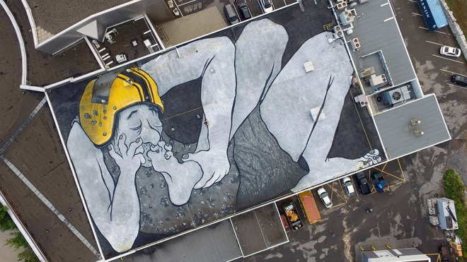 The large rooftop mural by French artists Ella and Pitr atop Science North depicts Michael Persinger and Stanley Koren's 'God Helmet' on a sleeping giant. Photo: Ella and Pitr.