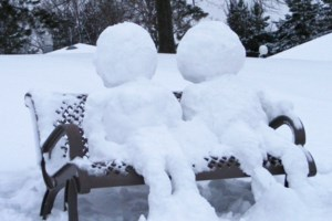 <b>Snowmen lounging on a bench in Bell Park</b>