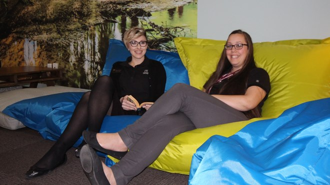 Cambrian College officially opened the Zen Den on Jan. 25. Librarian Marnie Seal and administrative assistant Natalie Guindon kick back on the den's beanbag chairs. Photo: Matt Durnan.