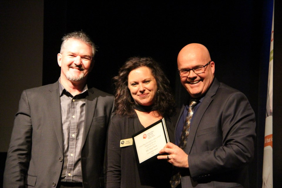 United Way campaign chair Paul Kusnierczyk, Kelly Sinclair, donor relations, United Way, with Scott Sonder who accepts a Cornerstone Award on behalf of RBC. Photo: Matt Durnan