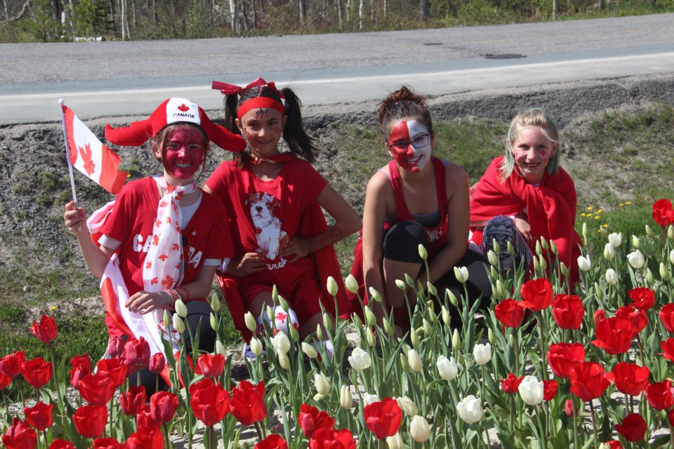 Valley View Public School Grade 5 students (from left) Addison Johnstone, Samantha Bisaillon, Chloe Vincent and Haydyn Sulston pose by their school's Canadian flag tulip bed. The school planted the tulip bed last fall after they won 500 red and 500 white tulip bulbs as part of the Canada's150th Anniversary Celebration Garden Giveaway, spearheaded by the Canadian Garden Council. To celebrate the blooming of the tulips, the school held an early Canada Day celebration May 18. (Heidi Ulrichsen/Sudbury.com)