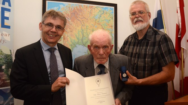 Finlandia Village resident Viljo Virtanen, a Finnish war veteran, was presented with the First Class medal of the Order of the White Rose by Vesa Lehtonen, Finnish ambassador to Canada. Virtanen's youngest son, Ray, is also pictured. (Arron Pickard/Sudbury.com)