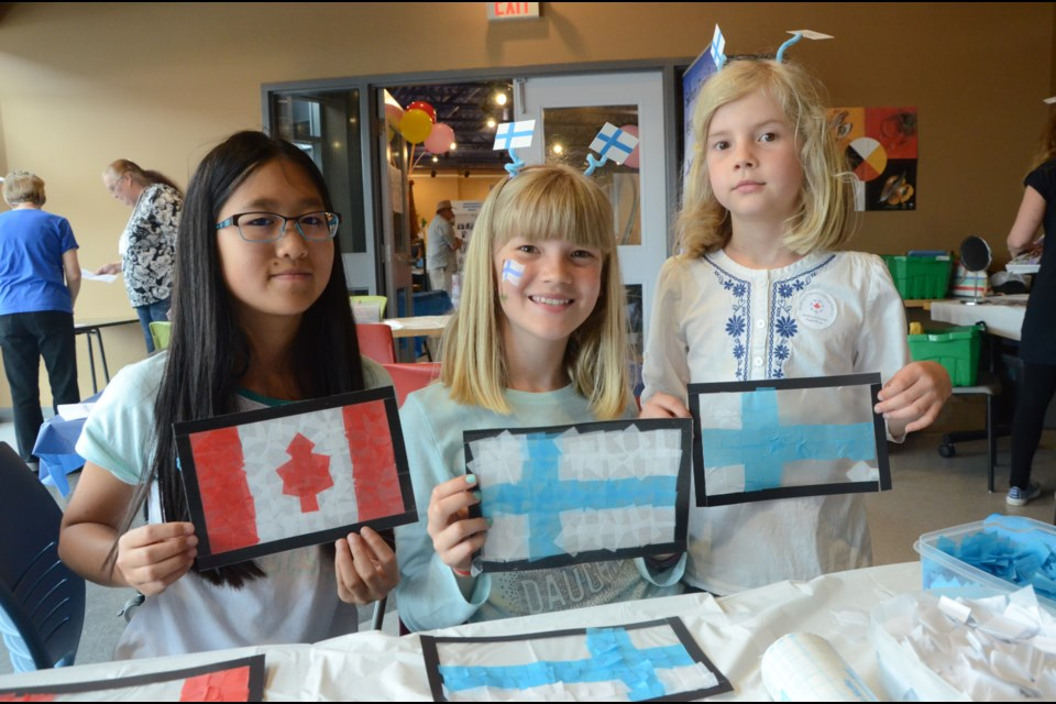 Showing their skills at making flags is, from left, Melissa Wen, 12, Heli Maki, 11, and Lea Maki, 9. (Arron Pickard/Sudbury.com)