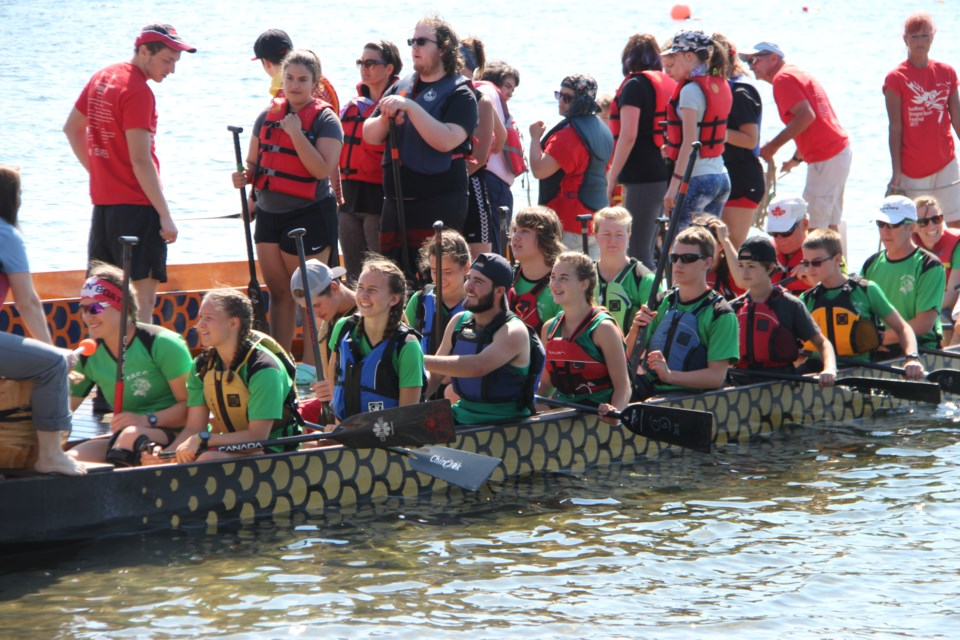 Ramsey Lake is alive with sweating paddlers, hollering drummers and intricately decorated watercraft today for the 18th annual Sudbury Dragon Boat Festival. (Photo: Matt Durnan)