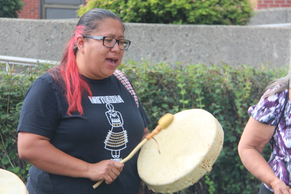 Crystal Kimewon, a member of the N'Swakamok Women's Hand Drummers, performs as part of the Prisoners' Justice Day ceremony outside of the Sudbury Jail Aug. 10. (Heidi Ulrichsen/Sudbury.com)