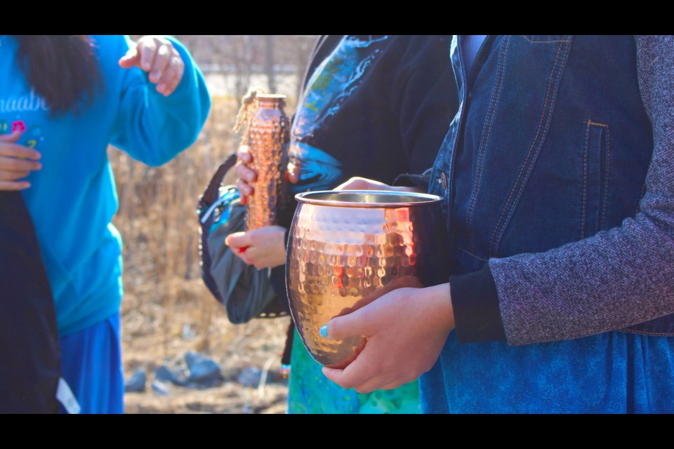 a copper vessel and an eagle staff st benedict students walk for