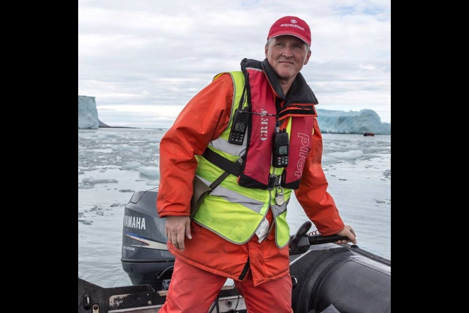 For months at a time, Sudbury musician Kevin Closs works aboard small adventure cruise ships in the Arctic and Antarctic, taking passengers out on Zodiac boats, and at night, entertaining in the ships' tiny bars. (Supplied/Facebook)