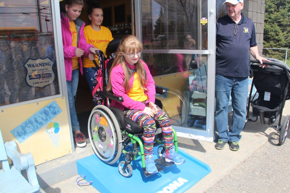 Katie Bellehumeur is now able to enjoy ice cream at Bitter Bill's Ice Cream Parlour in Val Caron thanks to a ramp installed there May 15 through the non-profit community group Access2all. (Heidi Ulrichsen/Sudbury.com)