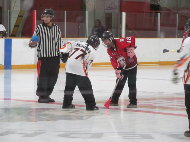 040918-file-AWSCO-native-hockey-official