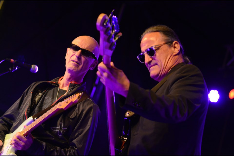 Kim Mitchell and bassist-vocalist Peter Fredette have been entertaining crowds together since 1983. Their chemistry was appreciated at the 43rd Valley East Days Rock Night concert on September 7, 2018. (Marg Seregelyi/Sudbury.com)