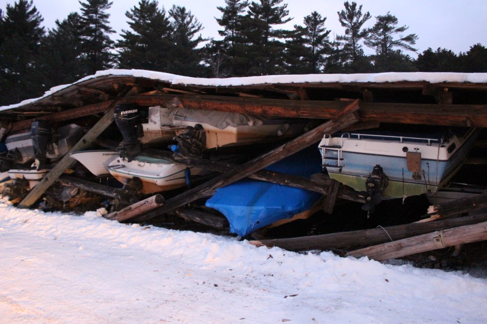 A wooden structure at the Penage Bay Marina in Whitefish collapsed late last week, destroying or damaging the several dozen boats stored there. (Matt Durnan/Sudbury.com)