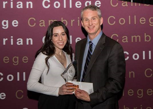 Female Athlete of the Year, volleyball player Isabelle Rivest, with Cambrian College President Bill Best. (Supplied)