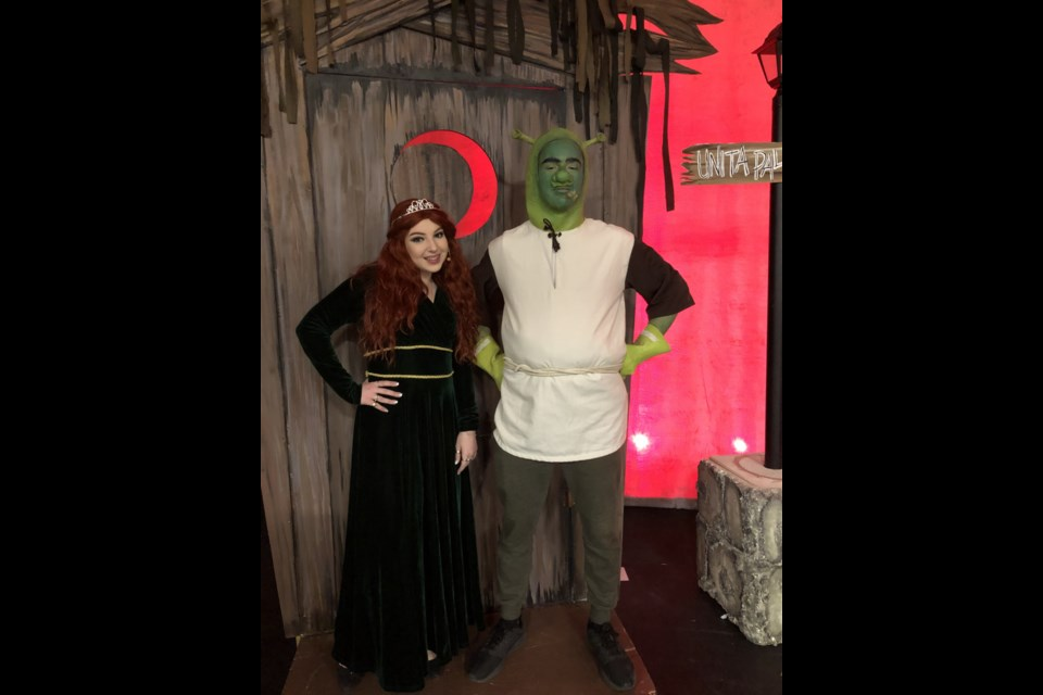 Trinity Thibeault (left) and Ryan Vendette dressed up in their Shrek and Fiona costumes