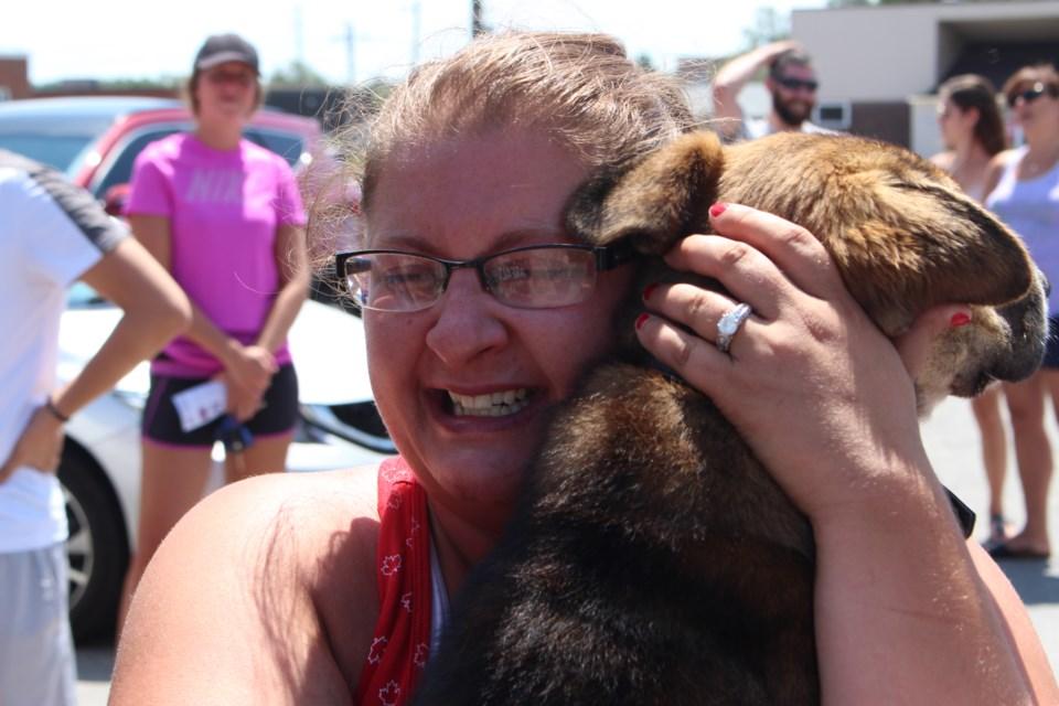 Amanda Gray holding Watson, at the Ontario SPCA adoption party hosted by First Round Sports Bar. (Keira Ferguson/ Sudbury.com)