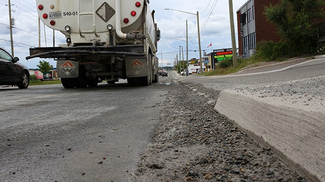 A 10-block section of Lorne Street had to be cleaned up this afternoon after a concrete truck spilled some of its dry load along the roadway. (Keira Ferguson/Sudbury.com)