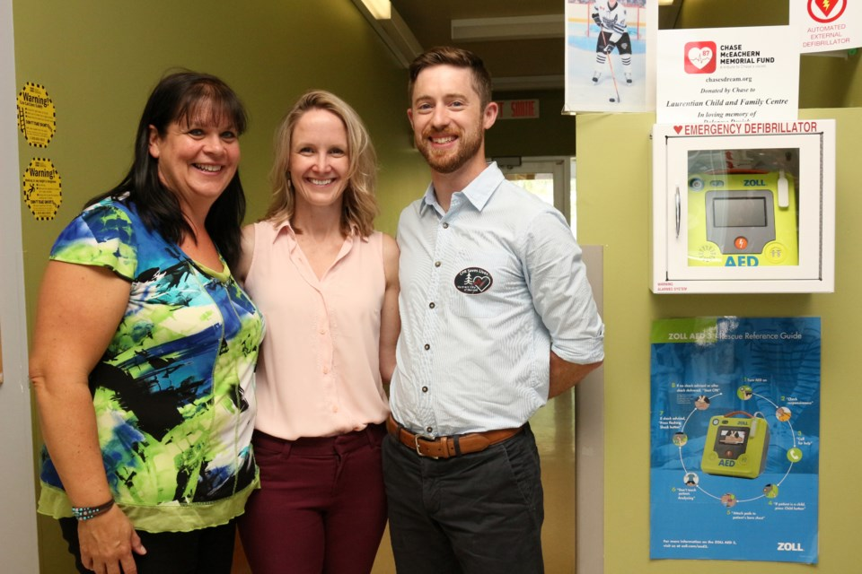 (From the left) Theresa Mills, executive director of the Laurentian Child and Family Centre with Dr. Sarah McIsaac and Dr. Robert Ohle, founders of the Northern City of Heroes initiative, at the presentation of the daycare's new Automated External Defibrillator. (Keira Ferguson/ Sudbury.com)