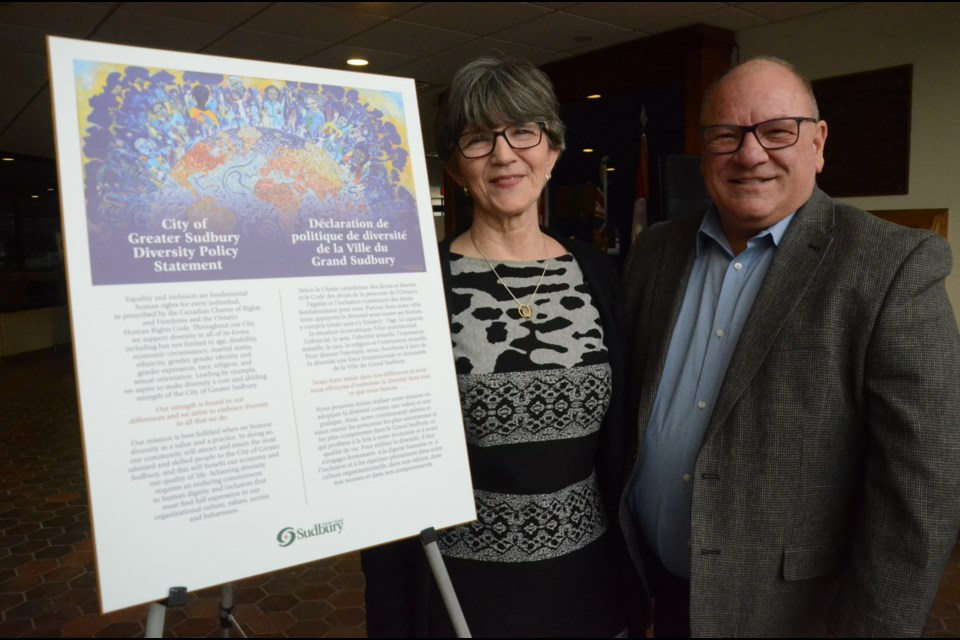 Mayor Brian Bigger and Ward 9 Coun. Deb McIntosh, co-chair of the Newcomer Immigration Refugee Advisory Panel, show off the new Diversity Plaque that will act as the city's promise to accept the differences every resident, regardless of where they come from. (Arron Pickard)