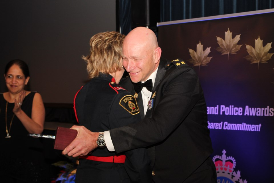 GSPS chief Paul Pedersen embraces Sgt. Joanne Pendrak, who received the Meritorious Action Award. (Photo: Matt Durnan)