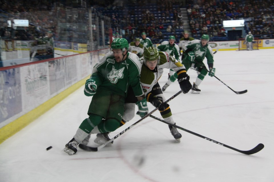 The Sudbury Wolves and North Bay Battalion played a scrappy, hard fought game on Friday night. Photo: Matt Durnan
